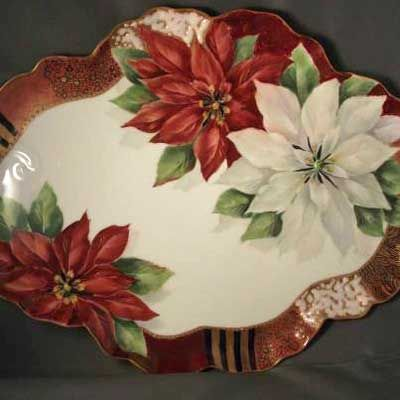 Painting of red poinsettias on porcelain tray by porcelain artist and teacher, Jane Wright.