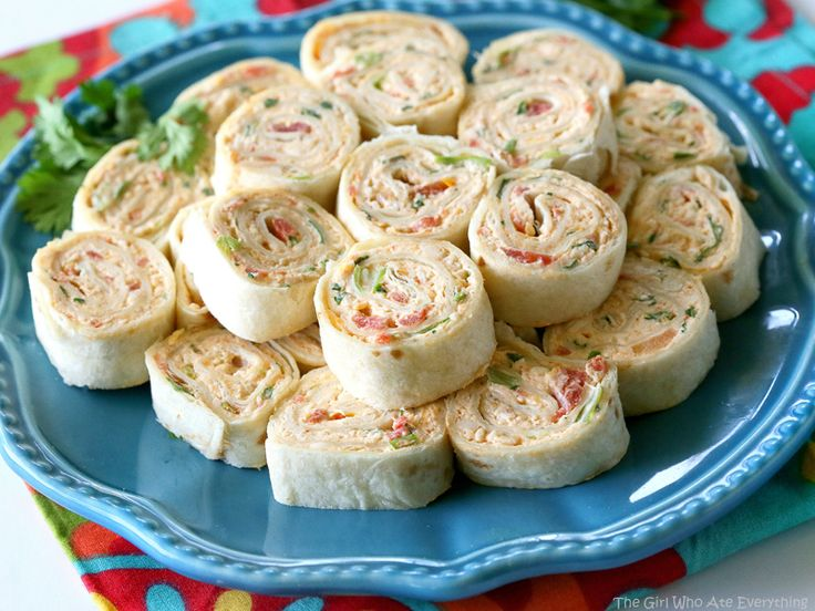 These Chicken Enchilada Roll Ups are a great appetizer for parties  Easy to make ahead and easy to serve  the girl who ate everything com