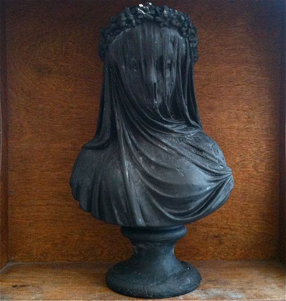 A vintage bust of a woman in mourning. It's a shame that mourning clothing is no longer largely a custom within society.