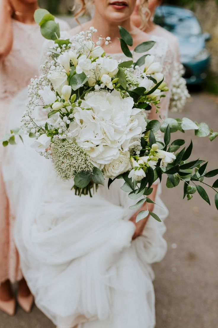 Beautiful bridal bouquet of ivory and greens by Dandy, Oxfordshire. Photo by Benjamin Stuart Photography #weddingphotography #bridalbouquet #weddingflowers #whiteandgreen #hydrangea