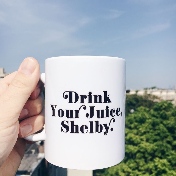 """Steel Magnolias is one of the most heartwarming and heart wrenching movies of the 90s and our """"Drink Your Juice, Shelby"""" mug pays homage to only the sass. Oh did we not mention the sass? Drink your coffee out of our 11oz ceramic """"drink your juice, Shelby"""" mug with it's classic southern typography and soon to be filled with your favorite beverage, but maybe skip the orange juice."""