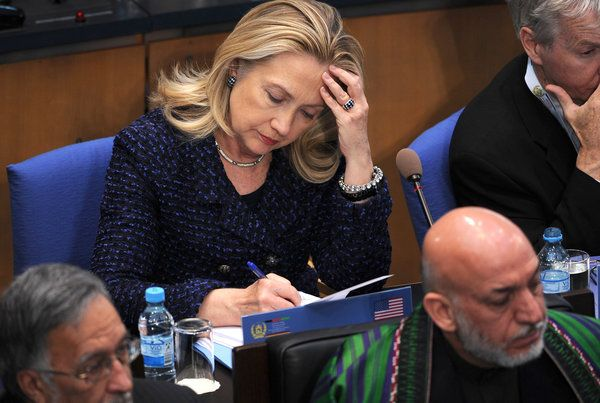 Secretary of State Hillary Rodham Clinton behind President Hamid Karzai of Afghanistan during a meeting in Germany in 2011. - http://www.PaulFDavis.com foreign policy consultant, international relations speaker (info@PaulFDavis.com)