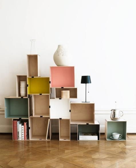 Above: Ikea's DIY version of stacked shelving, featured in Livet Hemma, is made of wood boxes with painted interiors, fastened with ordinary office binder clips.