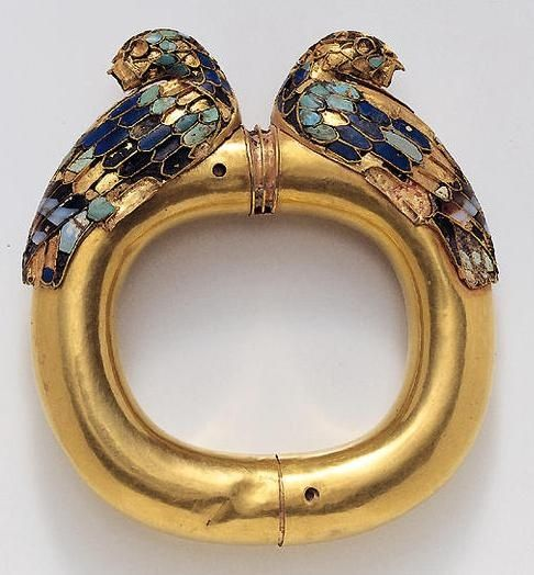 This is a Gold Achaemenid bracelet from ancient Persia.  It illustrates their artistic skills with the use of minerals.