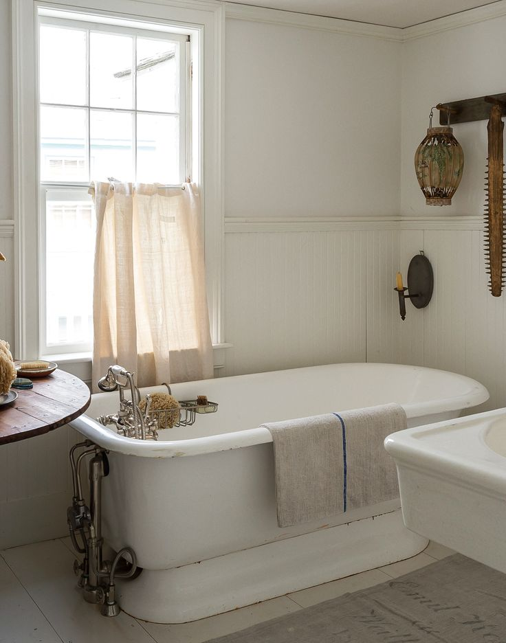 John Derian Bathroom - Deploying a combination of traditional fixtures, vintage pieces, and white paint, John set out not only to restore the original character of the bath but also to pay homage to the home's nautical past.