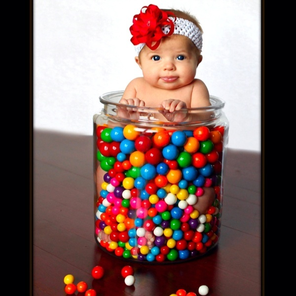 baby in Gumballs! Too cute!! She must be tiny to fit in there. I love the big gumballs best.