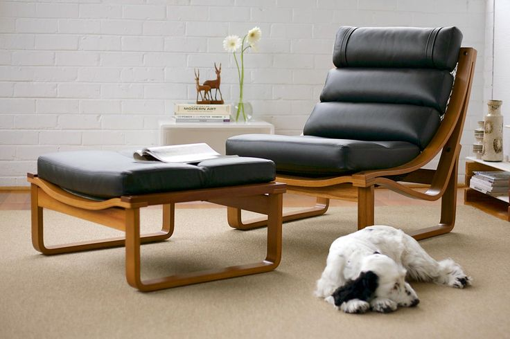 This beautiful Australian made Chair, which won Australian design Awards in the 1970′s, is crafted from Teak veneer with solid Timber rails. The Upholstery can be done in any cover of your choice, Fabric or Leather. The cushions are supported by unique Brown Nets which contour to your body shape. It is still made to the same specifications as designed by Fred Lowen in 1973. FIXED CHAIR: W76cm D91cm H88cm FOOTSTOOL: W76cm D76cm H38cm - See more at…