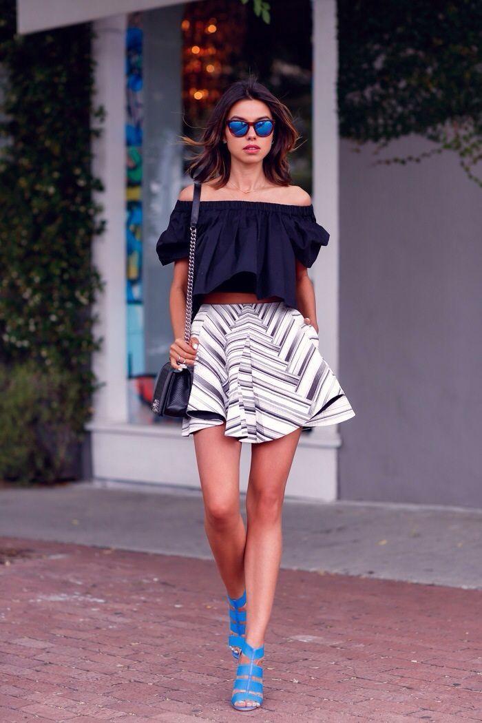 Black off the shoulder crop top & stripe skirt.