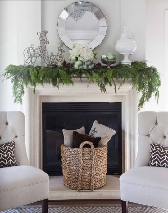 pure and crisp christmas mantle decor-need a basket like this for my living room pillows and blankets