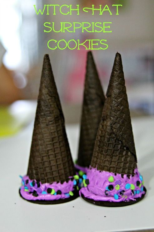 Oreo cone witches hat surprise treats! Could also make this a Christmas treat - make it a Christmas tree instead of a witches hat! Would be fun for kids to make! Fill the cones with candy corn (or other candy), put a chocolate cookie over the end of the cone, dip the edges (and even the tips if desired) of the cones in frosting then roll them in sprinkles, and you have a witches hat treat with a surprise inside!