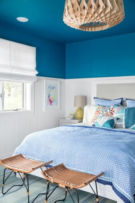 Tucked away on the home's first floor, the stylish guest bedroom designed by HGTV Magazine has a charming coastal flavor and serene feel.