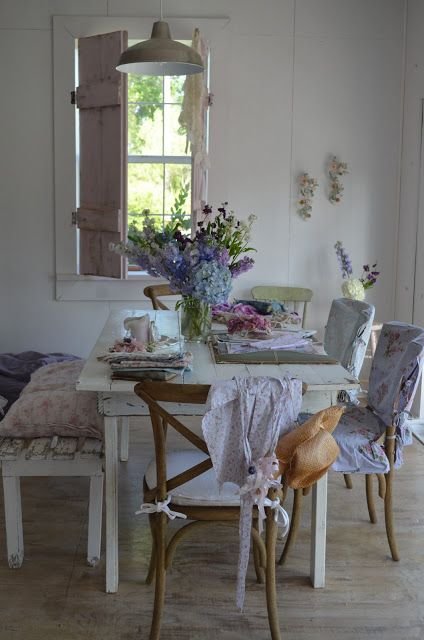 love benches at kitchen tables, also like the walls too. torn between painting the paneling white or the light gray.