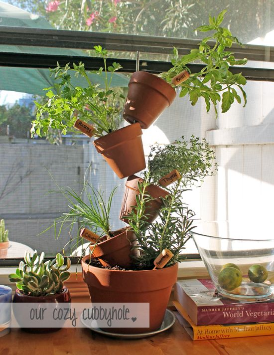 DIY Vertical Herb Garden - perfect for bringing your herbs indoors for the fall without taking up too much room! Great for small apartments.