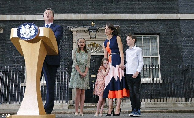 Prime Minister David Cameron speaks to the media as his wife Samantha and their children N...