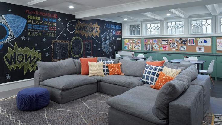 This playroom wins serious style points! The sofa uses perennials fabric for ultimate durability and has a soft frame so kids can climb and jump on it. The back of the room has built-in cabinetry for art supplies and a sink to wash brushes and messy hands. Colorful pillows keep the mood fun and light. Sofa: Restoration Hardware Cloud Sectional; Pillows: CB2