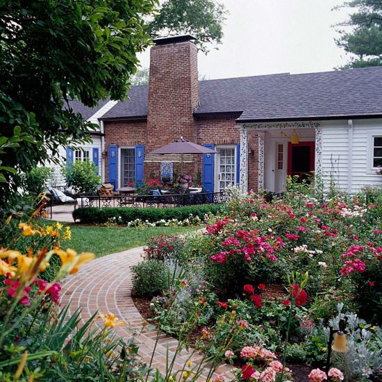 Front yard landscape...just one of sixteen great ideas.  Lots of variety.
