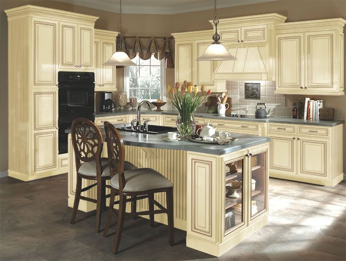 Kitchen idea 3 distressed cream cabinets this has tile for Almond colored kitchen cabinets