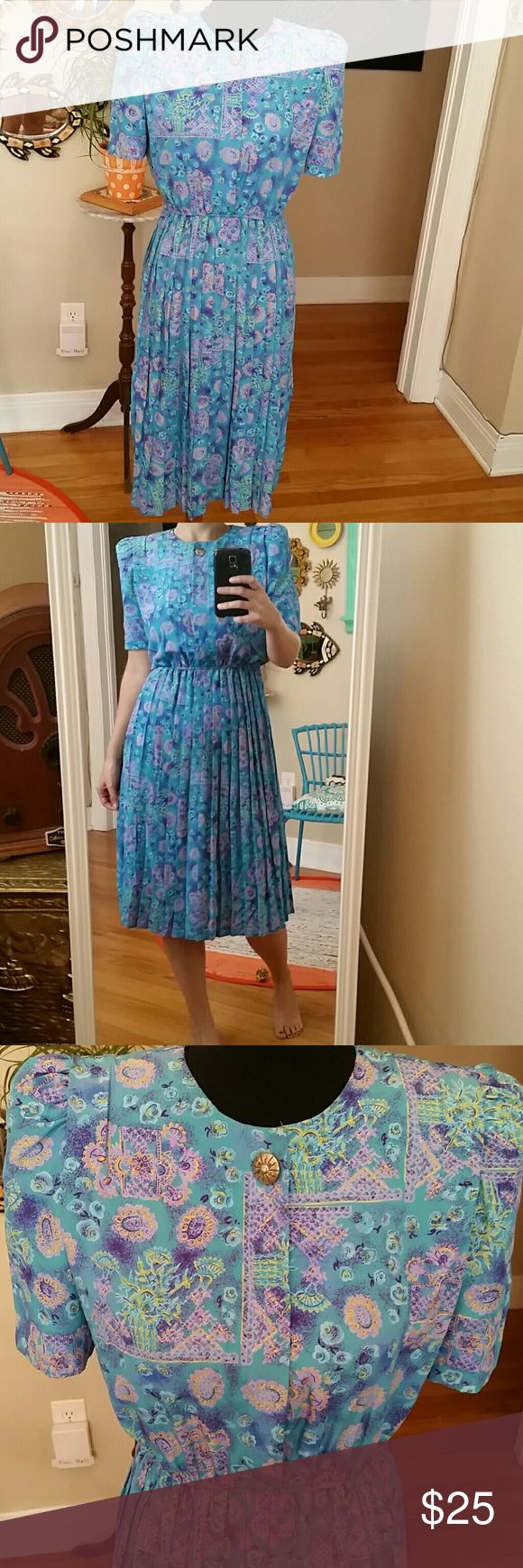 VTG Lady Carol Blue Pleaded Dress! Size 6!♡ Love love love this Lady Carol Petite dress! Pleaded skirt w/an elastic waist and strings for a belt around waist. Shoulder pads (can be easily taken out). Gorgeous gold button and 3 clear buttons down the front w/a small clasp on top. Would best fit a S/M 4-8. 100% polyestor, very light & flowy. Gorgeous bright aqua blues, purples, yellows and pinks. 1 of a kind vintage dress!♡ Vintage Dresses Midi