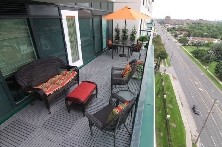 A double condo balcony we completed in Richmond Hill. One balcony has all blue grey tile and the other one is all grass.
