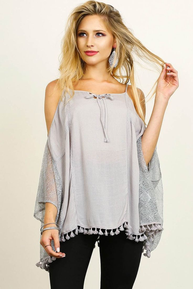 Open shoulder top with flowy lace sleeves and tassel trim around the hem. Content + Care: 60% Cotton 40% Linen Hand Wash