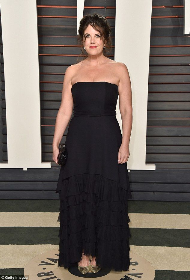 Monica Lewinsky wore a strapless black dress, gold pumps and carried a black clutch as she arrived to the Vanity Fair Oscar party on Sunday night