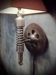 Resultado de imagen para imagenes de muebles o adornos echos de partes de motores de autos