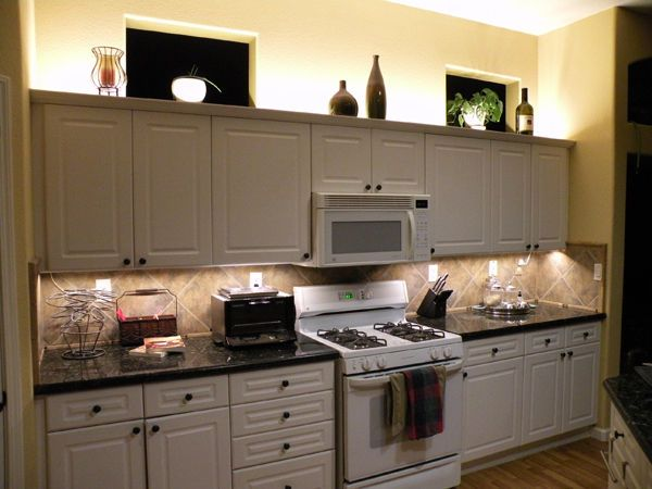 Under Cabinet: This is accent lighting because it emphasizes the kitchen and it adds style to the room. It can also be task lighting if you were to be cutting fruit or cooking.