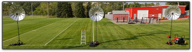 """Field Level: Three AlienBees B1600 640ws monolights aimed at PLM 64"""" Silver umbrellas. Click photo to enlarge (Photo by Rob Galbraith/Little Guy Media)"""