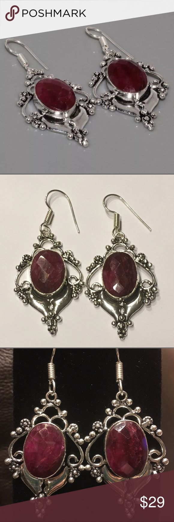 Faceted Natural Ruby Gemstone & Silver Earrings Faceted natural Ruby gemstone and 925 silver earrings. 2.2 inches in length from top of hook. Boutique Jewelry Earrings