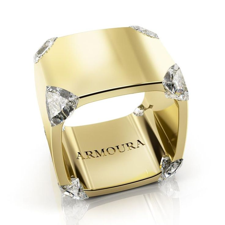 Armoura's Trilliant diamond ring in yellow gold has diamonds using a flush/hidden setting, which has embedded eight trilliant-cut diamonds in the 18 carat yellow gold band. The new and modern designers who are re-vamping the face of Irish jewellery design: http://www.thejewelleryeditor.com/jewellery/article/the-designers-redefining-irish-jewellery/ #jewelry