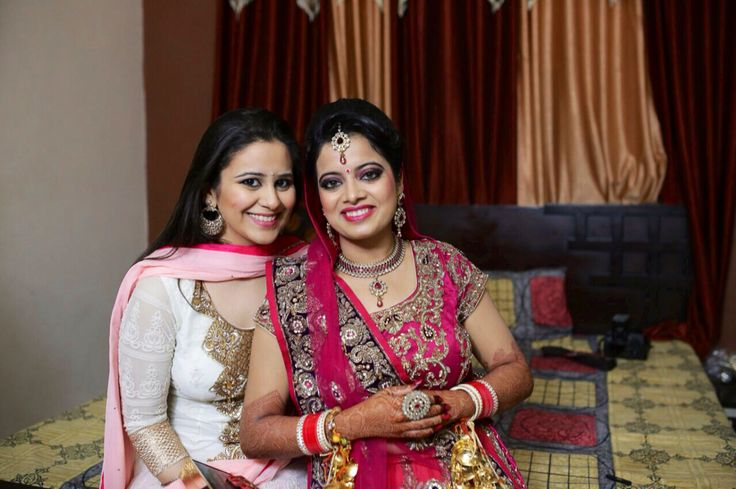 Indian bride and bridesmaid in pink