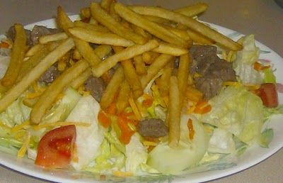 Steak Salad - Pittsburgh Style! There are many variations, but the three required ingredients are; steak thinly sliced, lettuce, I prefer some mixed greens and french fries. I like a homemade thousand-island (maybe it's the ketchup). And, I knew I first had it in Pittsburgh in the 70's.......
