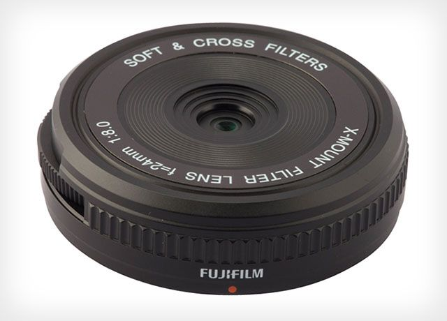 Fujifilm has announced a strange new lens over in Japan. It's called the XM-FL, and it's a 24mm f/8 body cap-style pancake lens that features built-in photo filters that can be accessed by turning a dial on the side.