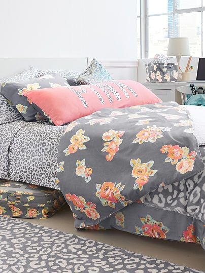 Such pretty bedding. Love the gray and coral