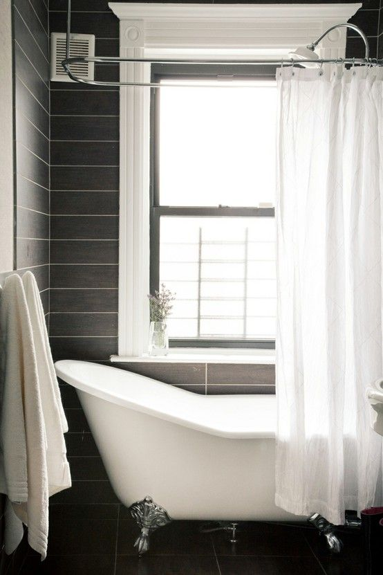 This slipper bath looks great with the more matte tiles.   We've just introduced a great range of bathroom tiles from ceramics manufacturer, RAK. - http://www.victorianplumbing.co.uk/Ceramic-Bathroom-Tiles.aspx