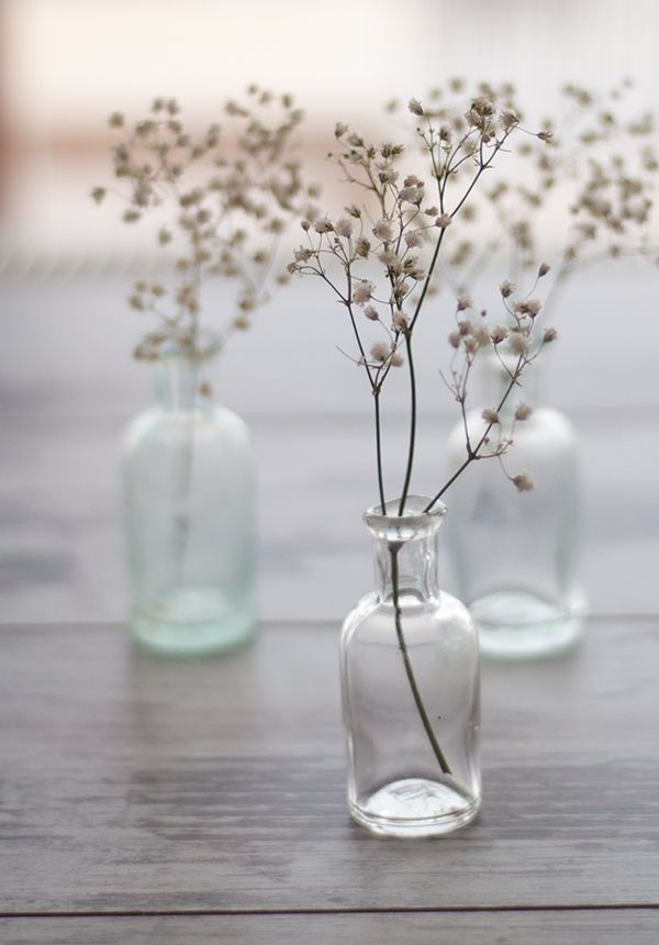 Antique Bottles filled with Baby's Breath | On the Horizon – Elegant Coastal Wedding Inspiration in Seaglass and Grays