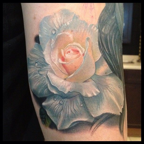 White rose tattoo by Phil Garcia. I would want something like this with daffodils instead