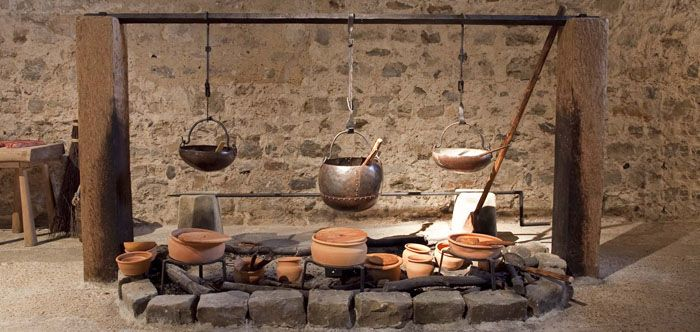 A recreated 12th-century kitchen range at Dover Castle, courtesy of English Heritage. This was an open-style kitchen, lacking a chimney to draw smoke out of the great hall.