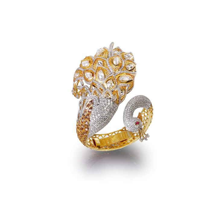 Farah Khan's peacock ring made in yellow gold and set with diamonds.
