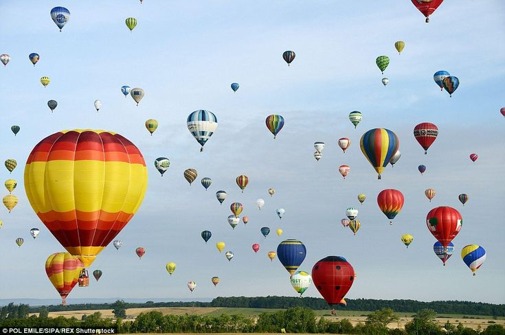 Firing up: The balloons transformed the skies over the air base into a sea of different co...