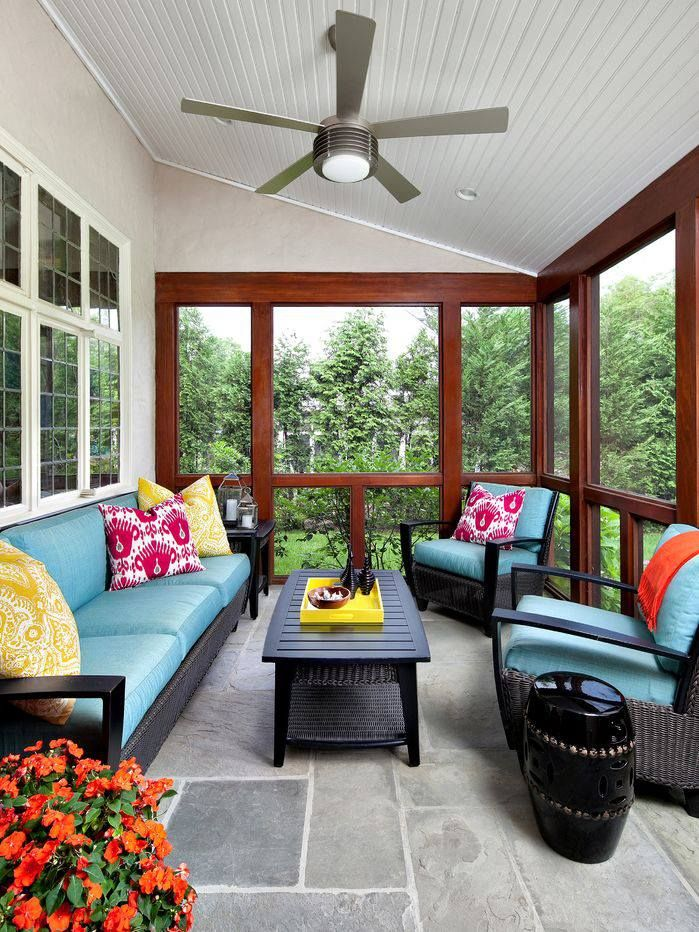 Black porch furniture blue cushions red and yellow for Screened porch furniture layout