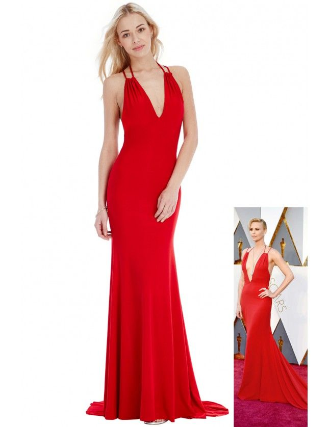 BB1850. In store now. If you are looking for a red, fitting, open back dress then this could be the one, A very similar look to a gown worn by Charlize Theron. More evening gowns on http://bridalandball.co.nz/ball-gowns/