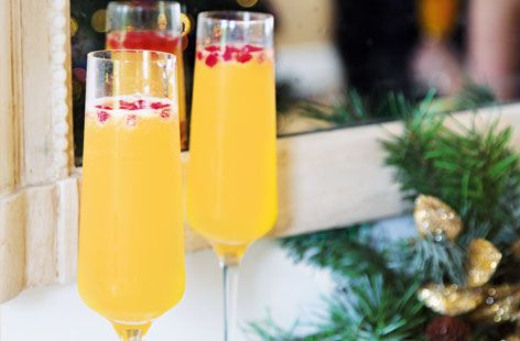 This easy Clementine fizz cocktail is served with pomegranate seed for a perfect New Year's Eve drink | Tesco