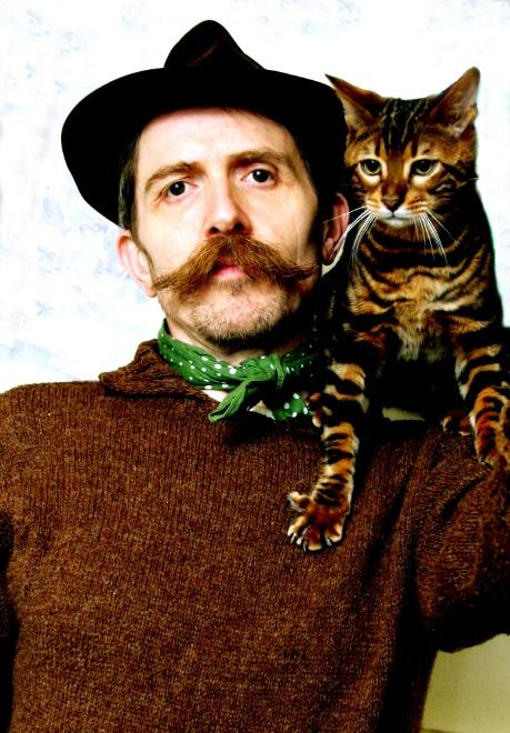 "Billy Childish, English artist and co-founder of the ""Stuckist"" movement, with his cat, Shackleton"