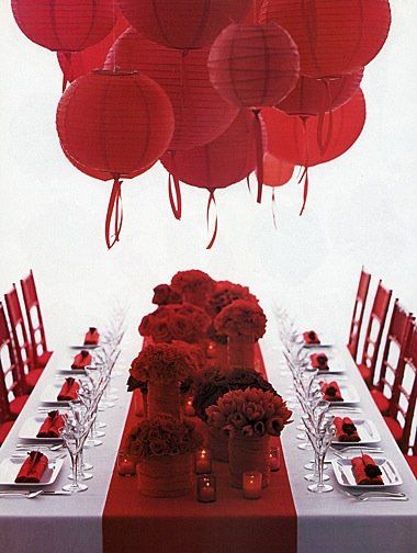 Clustering a big group of red lanterns is such a simple and affordable way to add instant drama to the room.  I would mix in some pinks and whites too.