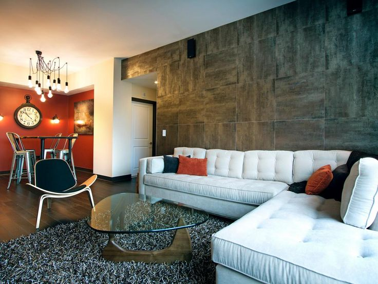 Burnt orange black and gray accents come together to - Burnt orange feature wall living room ...