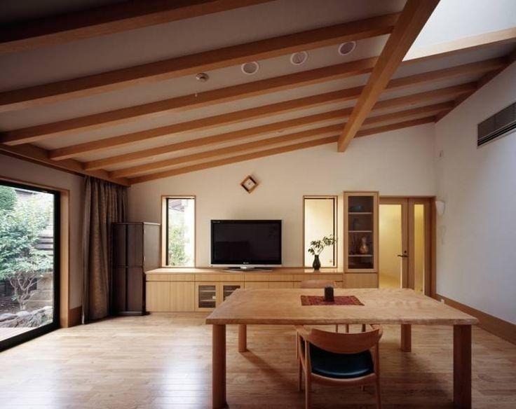 リビング: 忘蹄庵建築設計室が手掛けたアジアリビングです。