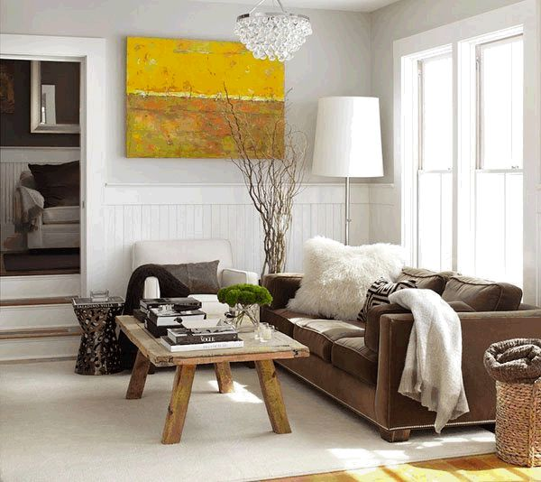 Brown couch with Modern, yet rustic decor.