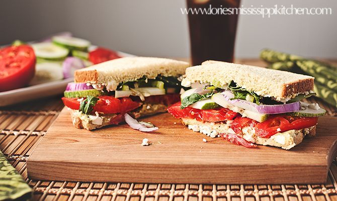 Copycat Panera Bread Mediterranean Veggie Sandwich    Zesty Peppadew™ piquant peppers, feta cheese, cucumbers, lettuce, tomatoes, onions and cilantro Jalapeño hummus on our Tomato Basil bread.