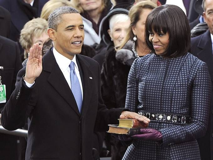 President Obama takes the oath of office from Supreme Court Chief Justice John Roberts as his wife, first lady Michelle Obama, holds two Bibles at the Capitol in Washington.  H. Darr Beiser, USA TODAY